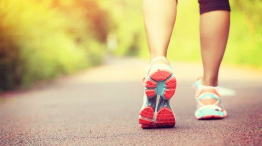 young fitness woman hiker legs at forest trail